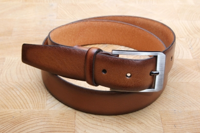 "<h5>2034 35</h5><p>Made in Germany belt "" Softy"" in black and cognac. Width 3,5 cm and length available till 115 cm. Description: Moulded, not stitched  and shortable</p>"