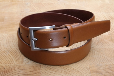 "<h5>2015 35</h5><p>Made in Germany belt "" Ascona"" in black, atlantic and cognac. Width 3,5 cm and length available till 115 cm. Description: Moulded, not stitched and shortable	</p>"