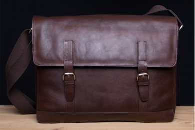 <h5>7813 06</h5><p>Messenger bag with flap in mocca and saddle. Size 24 x 29 x 5,5 cm. Description: zip comp on backside, front clamp comp. with 2 elastic clamp comp., 2 penholder, 5 credit card slots, main comp. with padded comp for laptop and I Pad , zip comp. and adjustable shoulder strap</p>